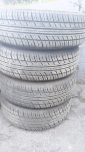 185/65R14 SET 4 BRAND NEW ALL SEASON TIRES ON 4 BOLT STEEL RIMS