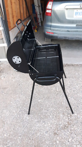 Charcoal BBQ for sale! 50 bucks! Never used. Brand new