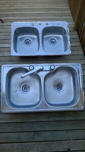2 Stainless double sinks one with faucet