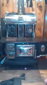 Antique Wood stove with water warmer