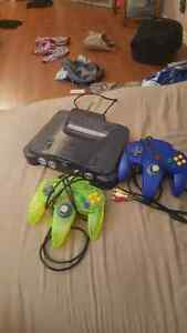 Nintendo 64 with controllers and games