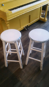 "Matching pair of white ""antiqued"" stools."