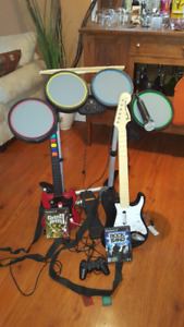 PS 2 Guitar Hero Drums, Guitars, Mike, controller and 3 games