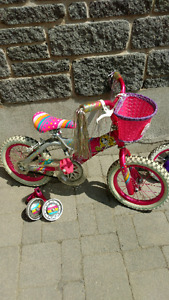 """Girl's 14"""" bike with basket and training wheels."""