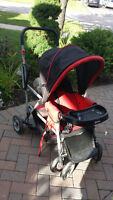 Black and Red Joovy Caboose Stroller.