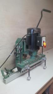 Multi/adjustable hole Drilling Machine by General International