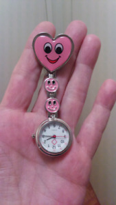 NURSE,  CAREGIVERS PINK SMILEY FACE CLIP ON POCKET WATCH.