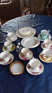 Assorted sets of cups and saucers.
