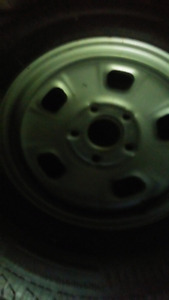 5 bolt dodge rims and tires (4). 150$ need gone
