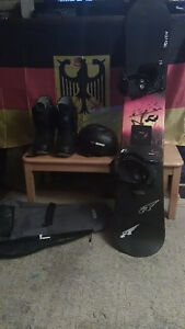 Barely used snowboard w/ bindings and gear included