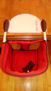 Chicco highchair hooks to table..