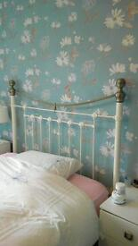White and gold double metal bed