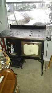 Antique six burner cook wood stove.