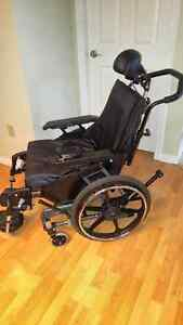 FOR SALE IN COMOX: HIGHBACK TILTING WHEEL CHAIR and CUSHION