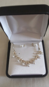 Delicate necklace set in box never worn.
