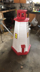 4 1/2 ft lighthouse with solar light.