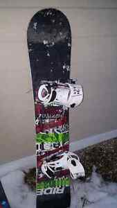 Rider snowboard with bindings and boots