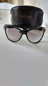 Authentic Gucci Sunglasses with Case.