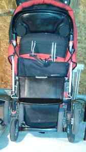 Joovy caboose sit and stand stroller.