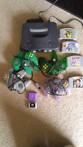 N64 . 4 controllers. Games. Memory cards