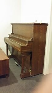 Antique Solid Oak Piano in Working Conditon