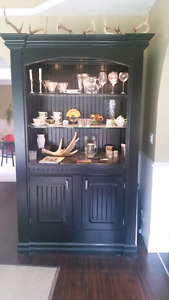 Massive hutch or display cabinet for a great room.
