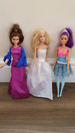 3 barbie dolls vgc £5 for all three blonde brunette & purple hair From