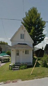 July 1st ~ Small home with large yard for rent