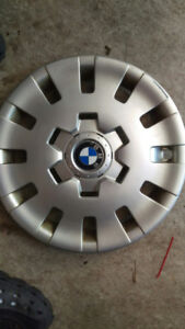 Four BMW 323i rims. Steel with hubcaps.