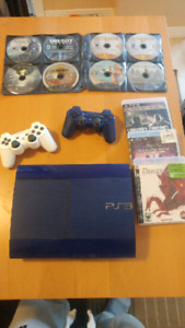 PS3 slim, 2 controllers, 15 games for sale
