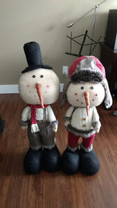Two adorable snowmen will melt your heart.