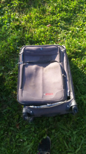 Grey swiss travel products suitcase.