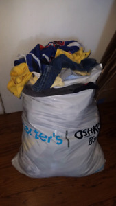 Stuffed bag full of boys baby clothes 3-6 months and 6 months