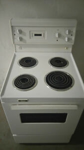 white digital apartment sized stove. Clean