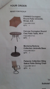 Patio Table set with four chairs and umbrella