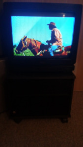 Free colour tv with stand!! Just come by and pick up!