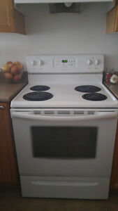 Fridge, (2)stoves, washer, (2) dryers (all in white)