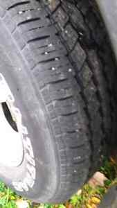 235-70-16 tire with wheel off a ford escape