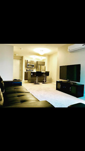 2 bedroom + flex fully furnished condo for rent