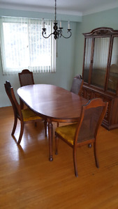 Solid oak dining table, four chairs and hutch