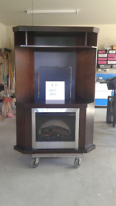 "Corner unit with electric fireplace. Holds 42"" Flat Screen"