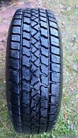 225/70R15 - 4 NEXT TO BRAND NEW ARTIC CLAW on 5 bolt rims