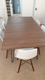 Extendable walnut dining table