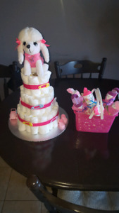 Baby shower diaper cake and diaper baby dolls