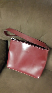 Leather Gucci purse made in Italy. Burgundy color.