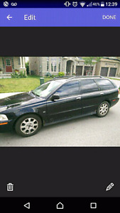 2003 black Volvo v40 wagon