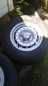 5 bolt 14 inch Mercedes rims with good tires (205-70-14)