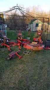 3 toro mowers, bagger, and sulky