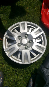 """4 universal hubcaps 16"""" one cracked but still holding"""
