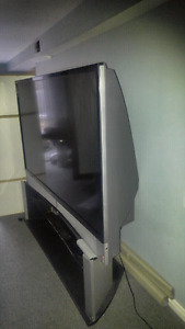Monster 72 inch Toshiba tv dlp new bulb recent tv stand too.